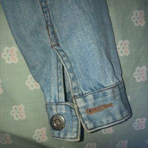 Jean jacket with studded shoulder detail
